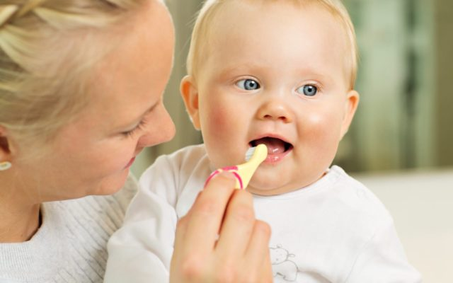 Brushing baby's teeth